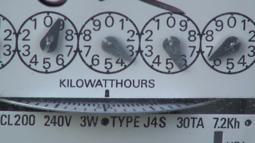 Macro view of a fast moving electric meter showing wasted energy