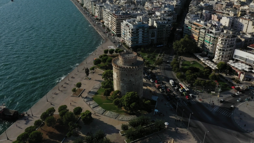 Thessaloniki, Macedonia, Greece - September 4, 2019: aerial orbit, circling, rotating shot showing White Tower of Thessaloniki, seaside prominade and city buildings | Shutterstock HD Video #1036879247