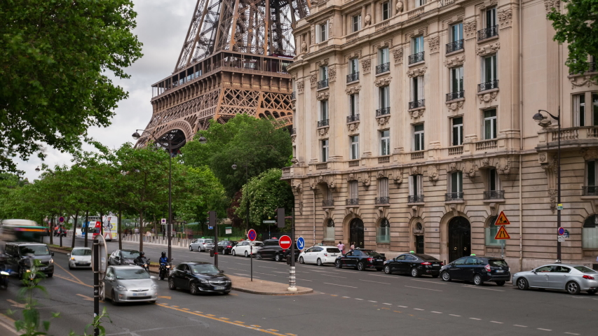 Street traffic time lapse near the Eiffel tower during rush hours in Paris. Summer cityscape, city life and famous touristic places and landmarks in Europe. Transportation and tourism concept | Shutterstock HD Video #1036968497