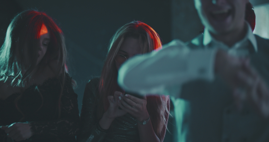 Young woman phubbing at xmas party. Christmas, new year, birthday, party, phubbing, lifestyle, generation z concept. Close shot on 4k RED camera with 12 bit color depth. | Shutterstock HD Video #1036972277