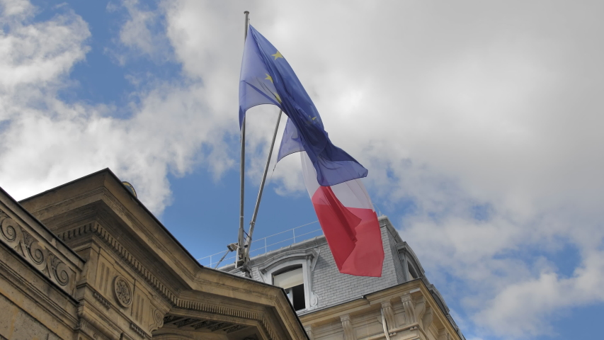 Flag of France and the European Union. Waves in the wind on a flagpole. Located on a traditional unrecognized French building. Slow Motion. | Shutterstock HD Video #1037140157
