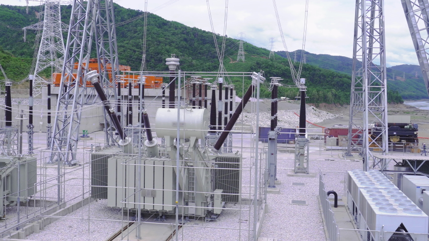 High voltage transformer at the hydroelectric dam.Large power generation systems connected to the city.Is an important technology of electricity.Clean electrical energy. | Shutterstock HD Video #1037147867