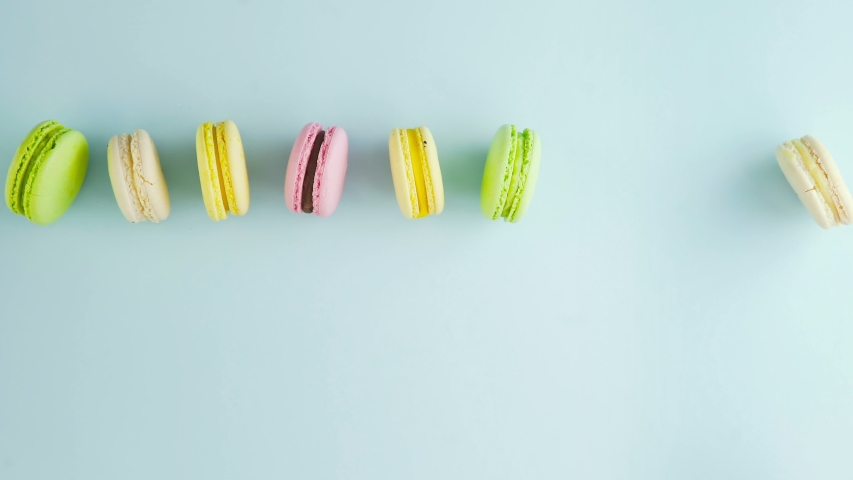 Sweet color macaroons or macaron on pastel blue background | Shutterstock HD Video #1037172677