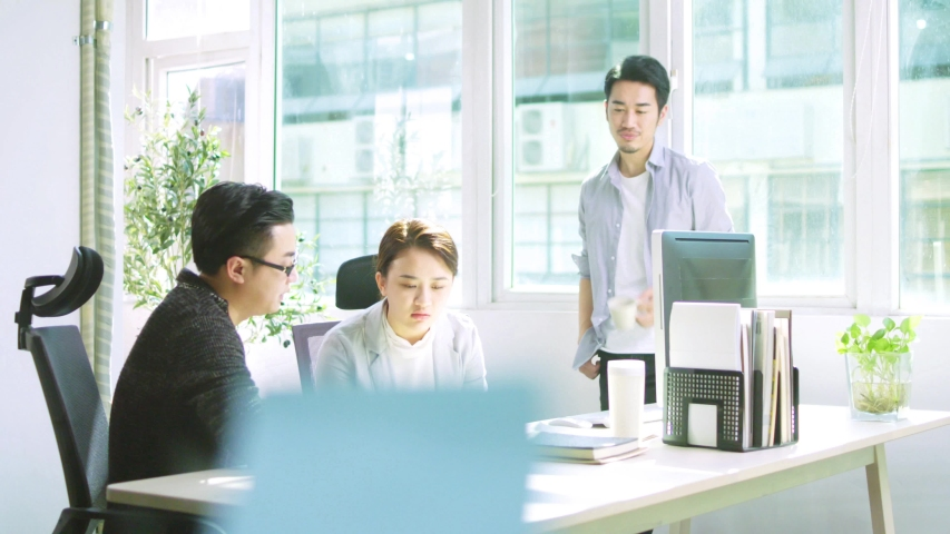 Team of young asian entrepreneurs meeting in office discussing business plan | Shutterstock HD Video #1037186687