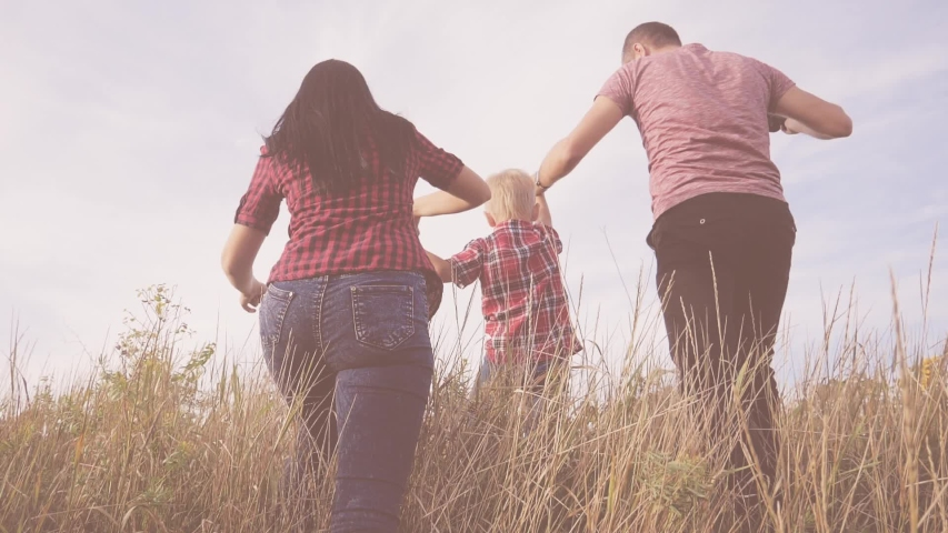 Happy family mom, dad and son walking slow motion video concept. mother girl, father man and son boy go in nature to a field lifestyle of sunflowers . happy family walk in nature   Shutterstock HD Video #1037217977