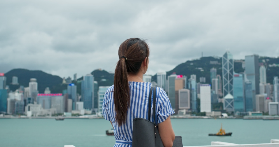 Woman look at the city view in Hong Kong | Shutterstock HD Video #1037289827