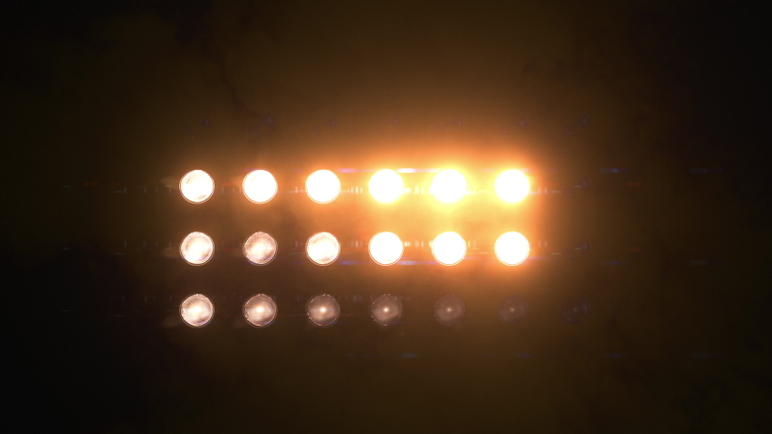 Orange flashing Lights Wall with smoke and particles. Various Looped Animations. Stage lights 7x4. VJ Floodlight Lights Flashing Wall. Shiny lights turning on and off. | Shutterstock HD Video #1037339057