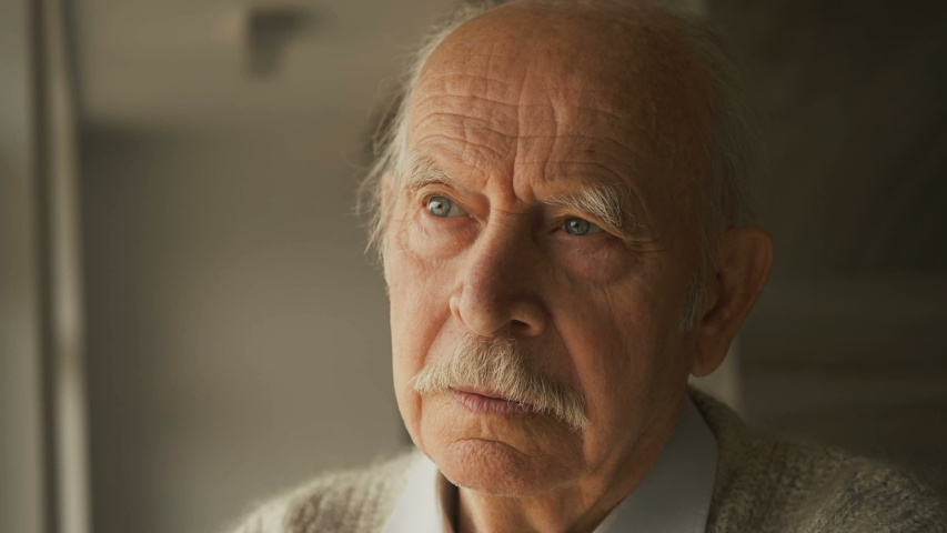 Pensive elderly senior man looking away feel upset, thoughtful melancholy older retired gray haired grandpa suffer from sorrow grief loneliness, sad grandfather widower alone at home, close up view | Shutterstock HD Video #1037442647