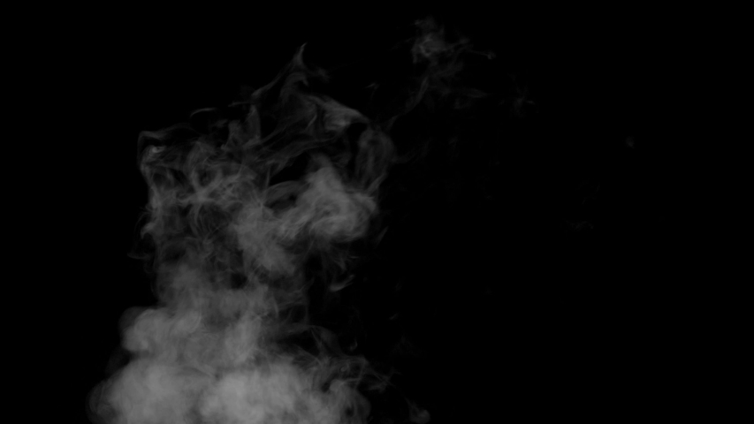 The smoke motion isolated on black background ,slow motion movement #1037503457