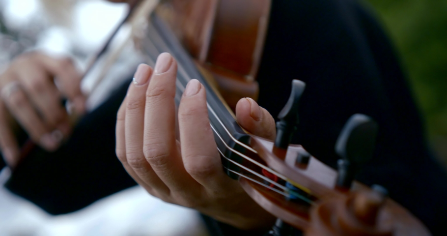 Close - up of a man playing the violin. He fingers the strings. | Shutterstock HD Video #1037625557