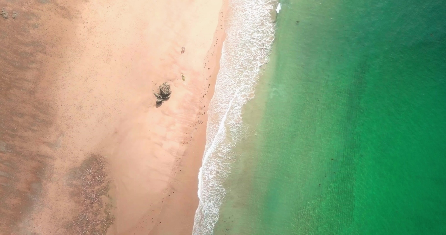[4K] Top Down Aerial Shot of Waves on a Sandy Beach in Brittany, France | Shutterstock HD Video #1037674457