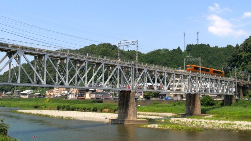 Japanese Kintetsu express train running in iron bridge | Shutterstock HD Video #1037771477