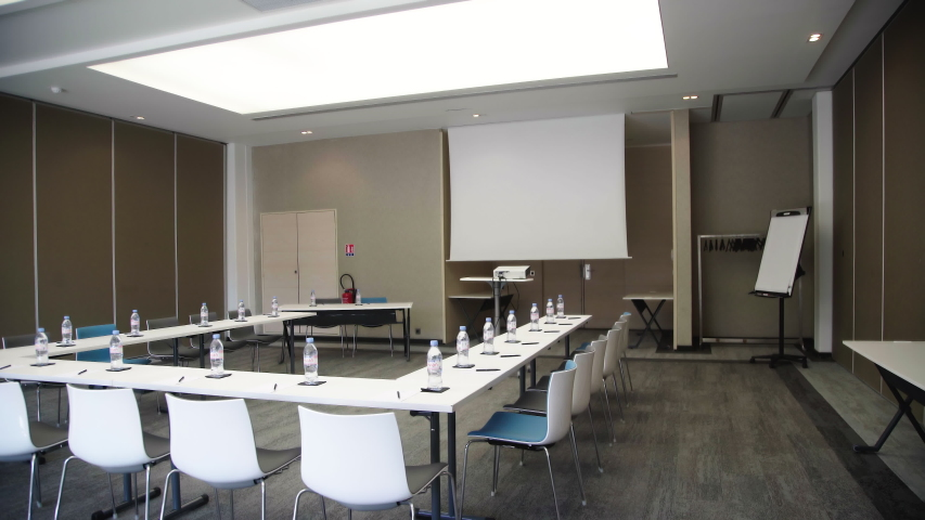 Sophia Antipolis, Alpes-Maritimes/France - 05 10 2019 : large conference room with water bottles  #1038210887