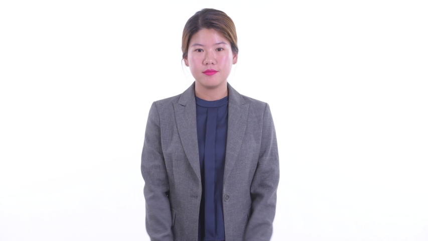 Happy young Asian businesswoman being interviewed | Shutterstock HD Video #1038336917