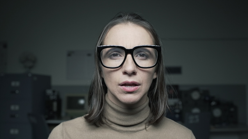 Woman staring at the computer screen and adjusting glasses, she has eyesight problems, point of view shot   Shutterstock HD Video #1038419747