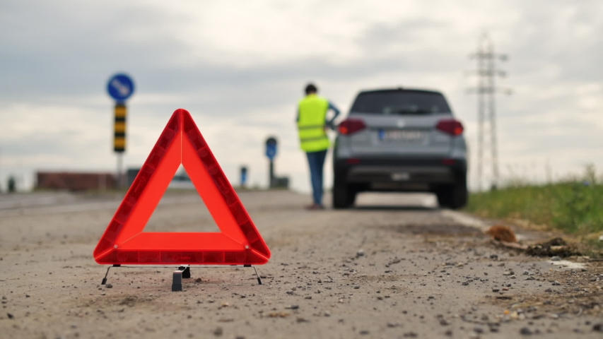 Vehicle breakdown on the road, woman using phone to ask for help and assistance | Shutterstock HD Video #1038531227