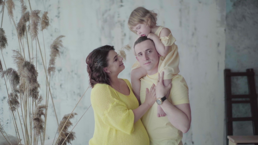 Little girl with her mother and father | Shutterstock HD Video #1038699677