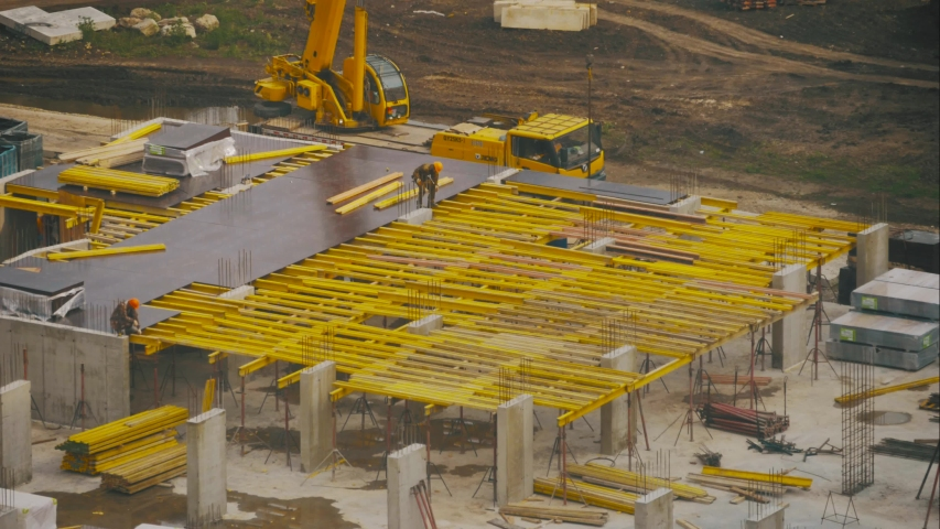 Timelapse video of construction site in beginning of building new housing project. Workers and machinery move fast and busy on development area. Construction site with motion cranes and trucks. | Shutterstock HD Video #1038711587