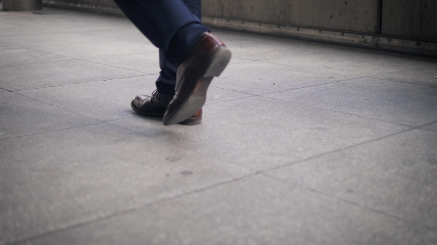 Close-up of the shoes of a walking businessman on the street | Shutterstock HD Video #1038862307