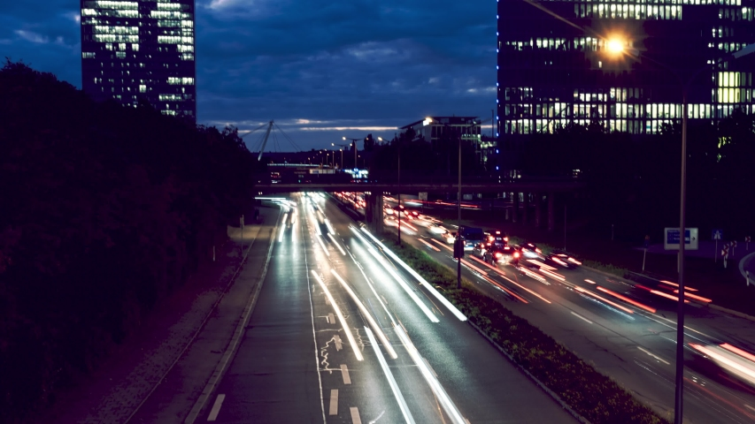 Timelapse of car traffic jam at busy street road highway long exposure light trails during dark evening night with munich skyline background | Shutterstock HD Video #1038977117