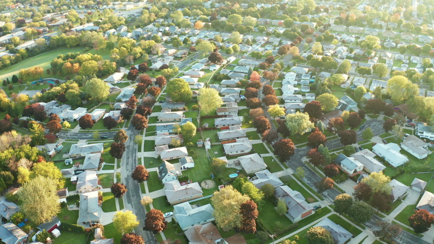 Aerial view of residential houses at autumn (october). American neighborhood, suburb. Real estate, drone shots, sunset, sunny morning,  sunlight, from above | Shutterstock HD Video #1039007927