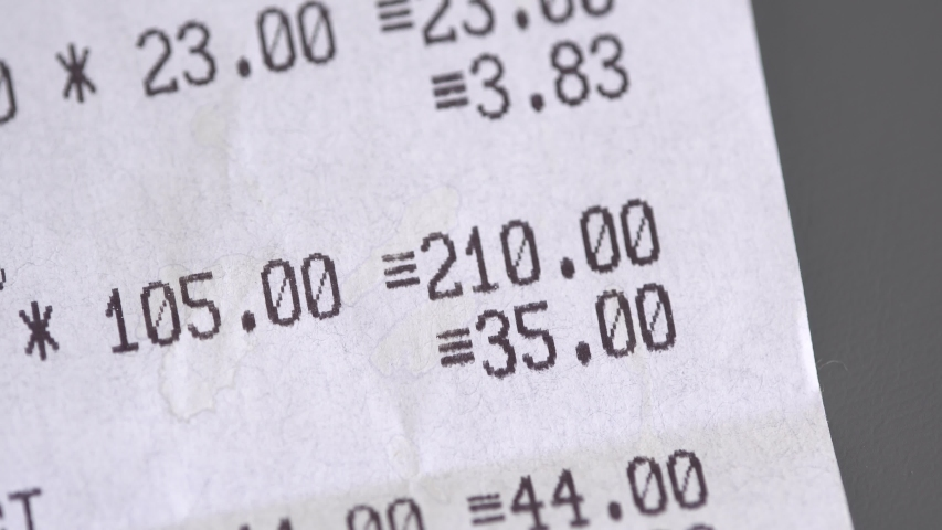 A paper receipt from the supermarket close up  | Shutterstock HD Video #1039076957