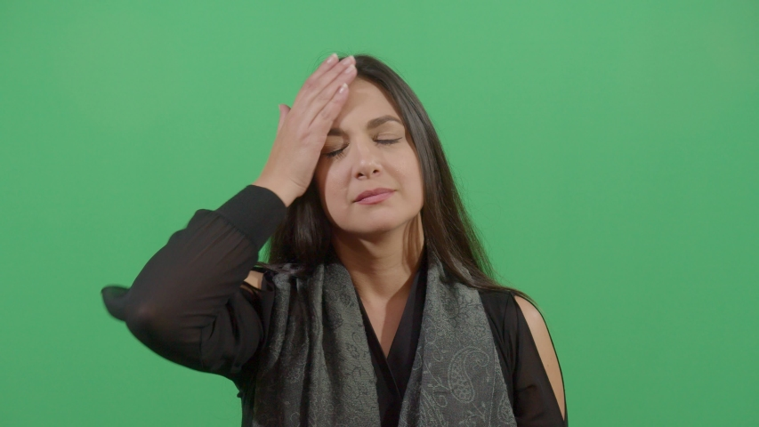 Woman Slapping His Forehead Suggesting Bad News Notice. Studio Isolated Shot Against Green Screen Background | Shutterstock HD Video #1039150877