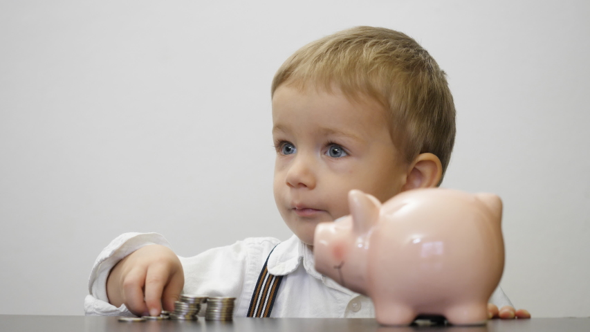 Portrait of child put money in piggy bank, early saving for a safe future   Shutterstock HD Video #1039195907