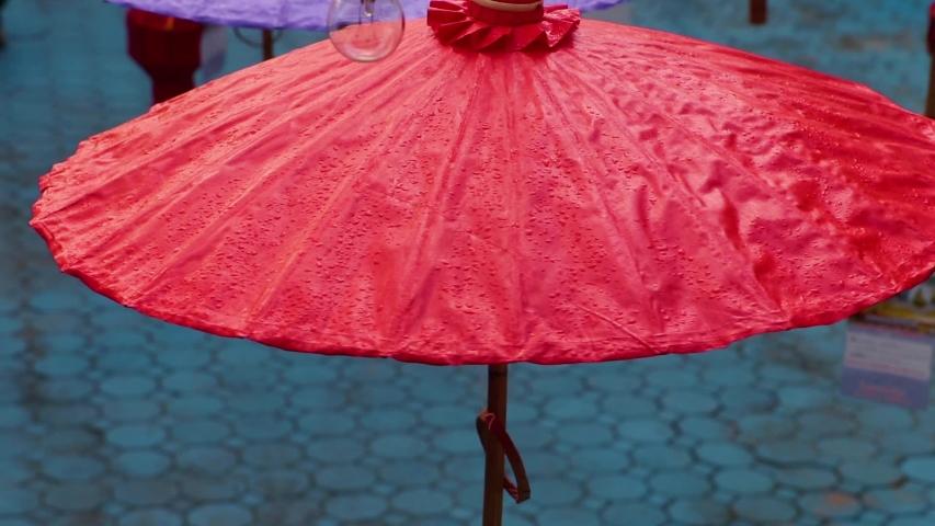 Umbrellas made of colorful fabrics, Thai crafts Lanna umbrella,Chiang Mai Thailand. | Shutterstock HD Video #1039281377