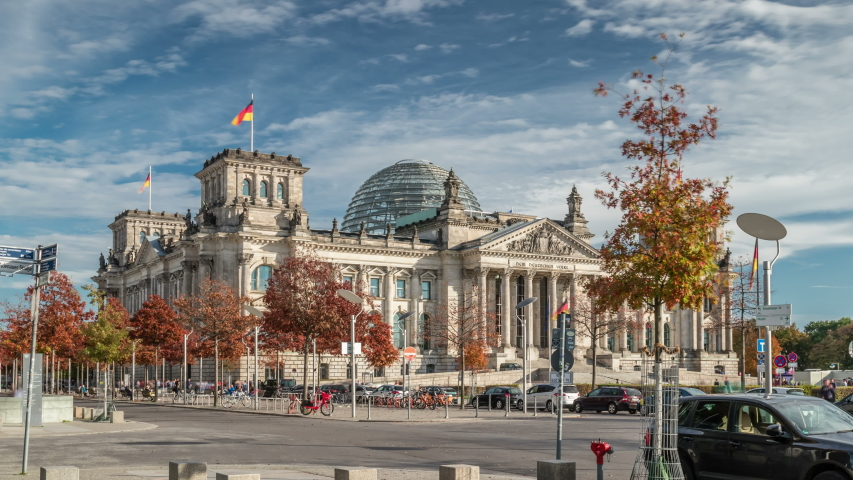 BERLIN, GERMANY - OCTOBER 20, 2019: Timelapse view of famous Reichstag building (german government), Berlin, Germany.