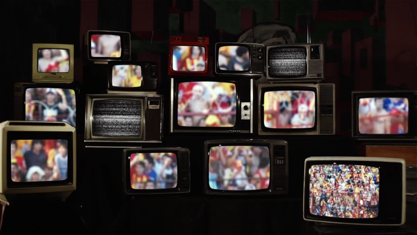 Cheering Crowd At A Soccer Stadium Tribune, Seen On Vintage Televisions. | Shutterstock HD Video #1039671677