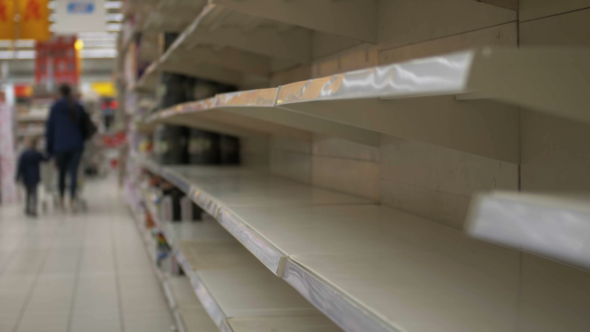 Empty shelves in store. Supermarket with empty shelves for goods | Shutterstock HD Video #1039686707