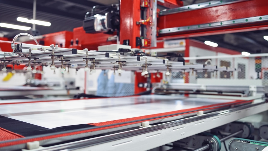 Production of solar panels, Industrial robot working in factory,Conveyor Tracking Controler of robotic hand. Closeup video. | Shutterstock HD Video #1039732997