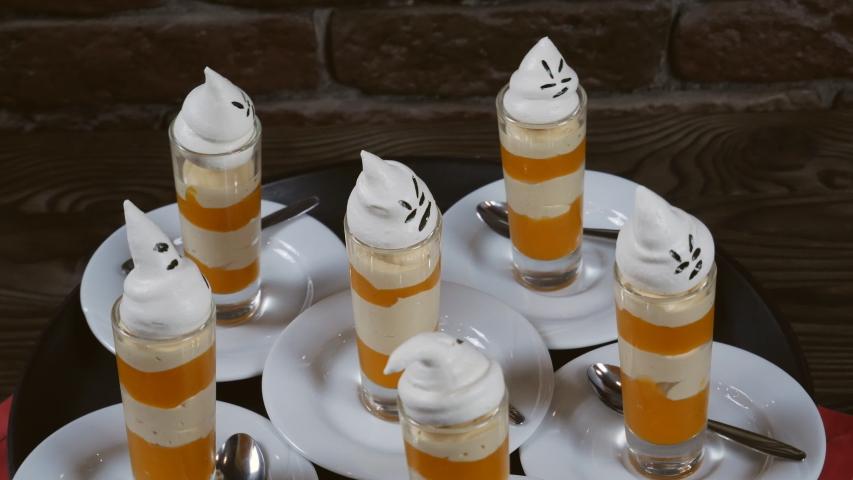 Presentation of pumpkin dishes. Pumpkin dessert. Pumpkin soufflé for Halloween   Shutterstock HD Video #1039869557