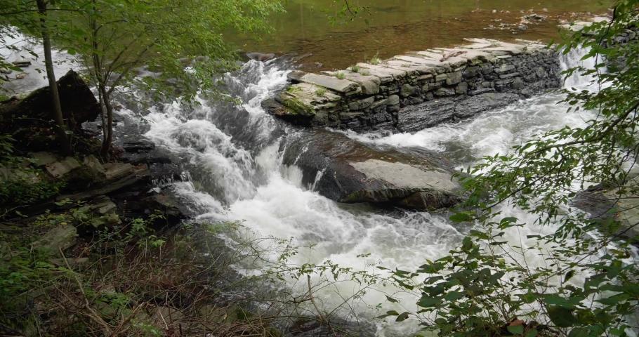 Waterfall near Covered Bridge, Thomas Mill at the Wissahickon Creek | Shutterstock HD Video #1040288147