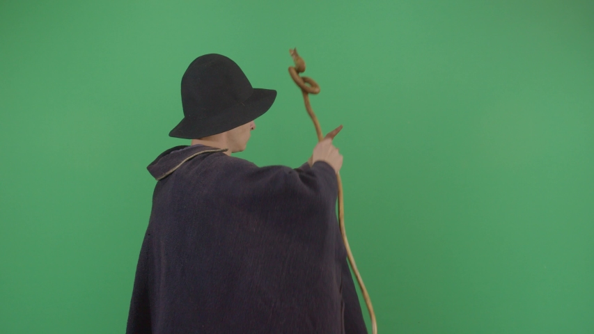 Adult Man Magician Opening A Portal On The Green Screen. Studio Isolated Shot Against Green Screen Background | Shutterstock HD Video #1040502227