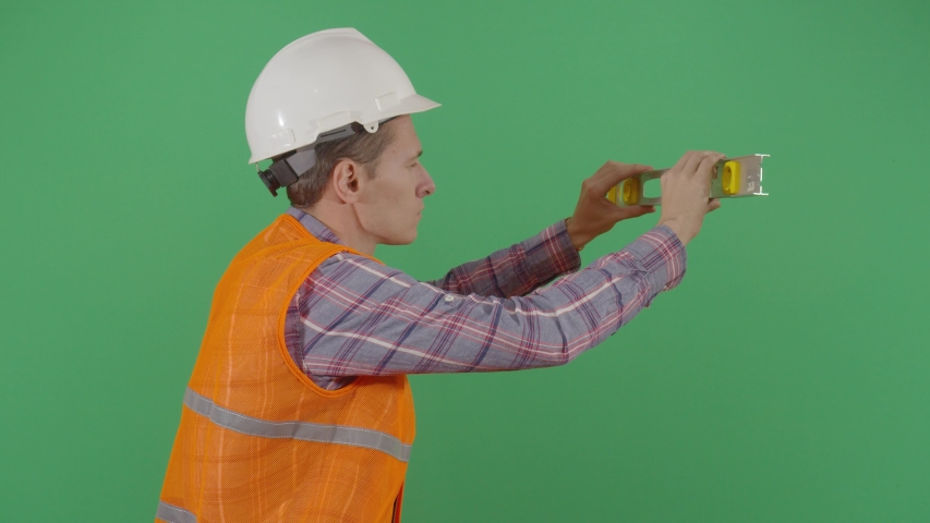 Adult Man Engineer Using A Level On Green Screen. Studio Isolated Shot Against Green Screen Background | Shutterstock HD Video #1040502257