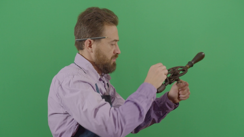 Adult Man Carpenter Testing A Drill On The Green Screen. Studio Isolated Shot Against Green Screen Background | Shutterstock HD Video #1040503397