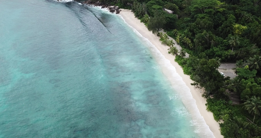 Seychelles beach. sand and ocen. beautiful tropical seashore by indian ocean.