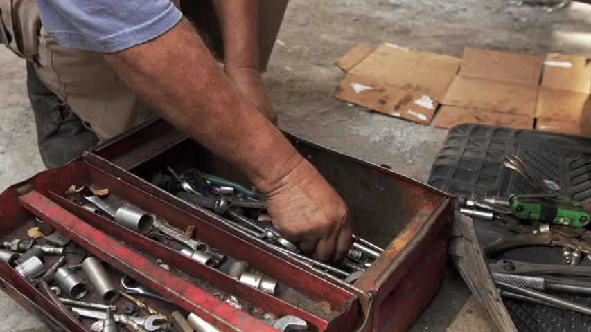 Mechanic hand in the toolbox | Shutterstock HD Video #1040684297