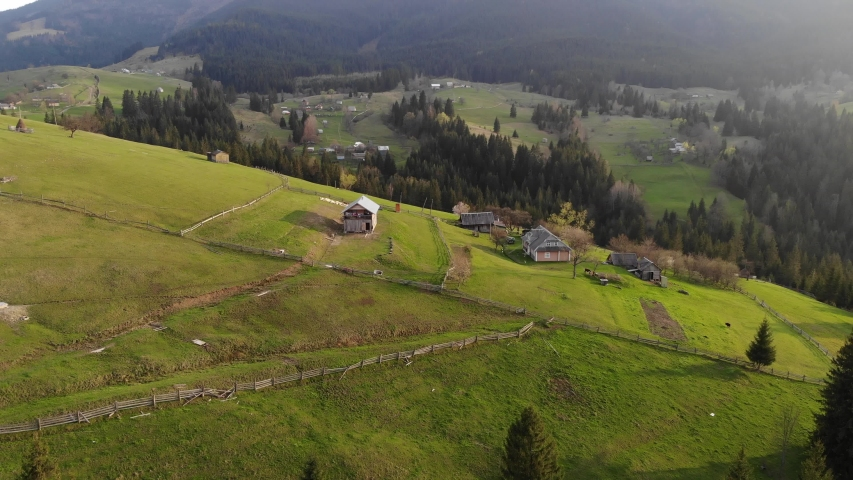 Beautiful aerial drone footage of little highland village surrounded with Carpathian mountains and green forest.Travel destination for active tourism in Western Ukraine. | Shutterstock HD Video #1040687327