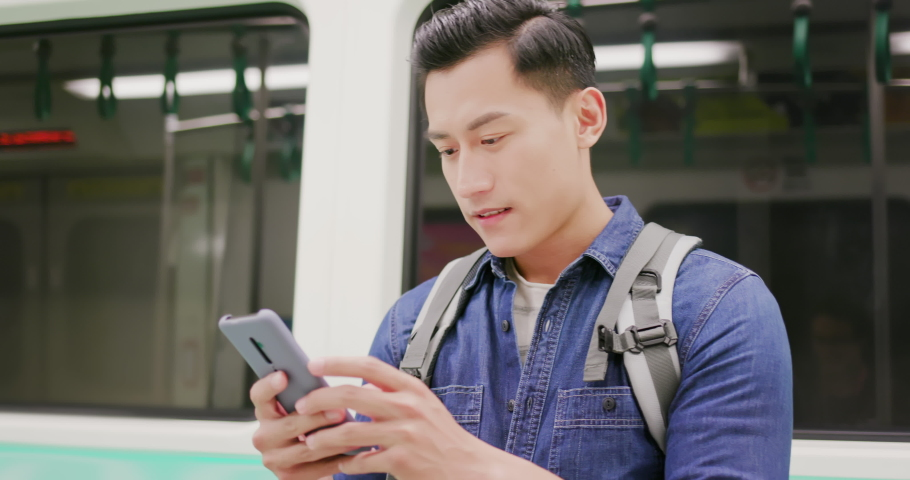 Close up of asian young man use 5g smartphone on the mrt or train | Shutterstock HD Video #1040827397