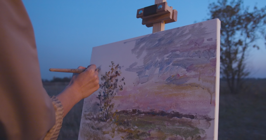 Beautiful piece of art on easel, artist making final stroke with brush on canvas   Shutterstock HD Video #1041088207