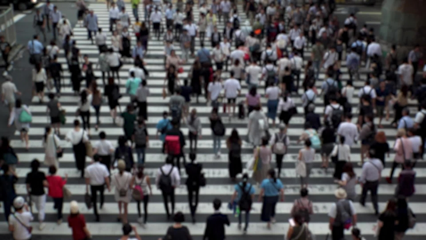 UMEDA, OSAKA, JAPAN - CIRCA SEPTEMBER 2019 : Aerial blurred high angle view of zebra crossing near Osaka train station. Crowd of people at the street. Shot in busy rush hour. Wide slow motion. | Shutterstock HD Video #1041098737