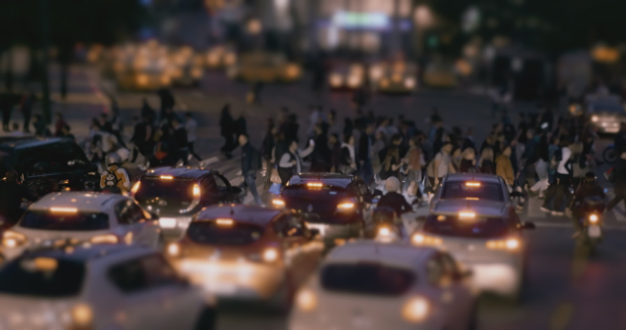 People and shoppers cross a busy city street.People and traffic in a busy European city at night. | Shutterstock HD Video #1041136837
