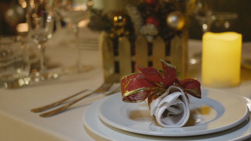 Christmas table setting. Christmas table decoration, banquet Christmas table | Shutterstock HD Video #1041169867
