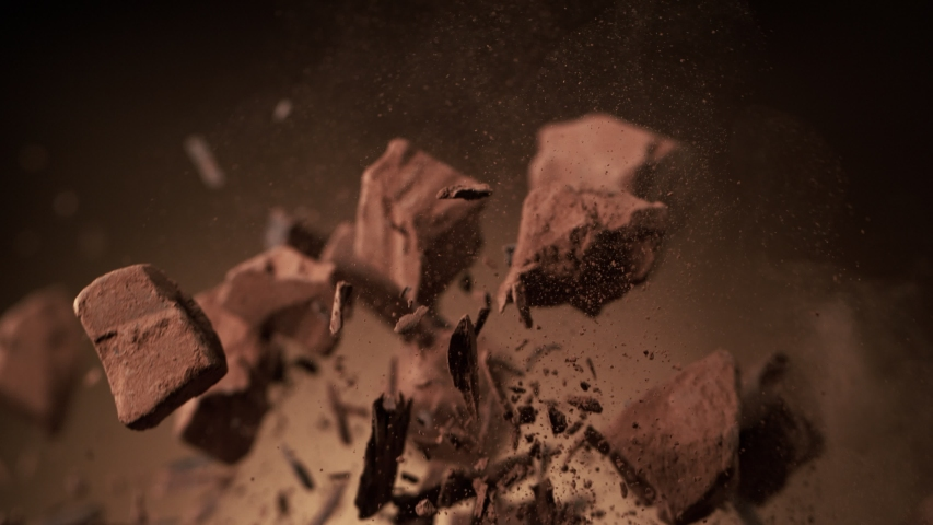 Super slow motion of flying raw chocolate pieces with ramping speed effect. Filmed on high speed cinema camera, 1000fps. | Shutterstock HD Video #1041180817