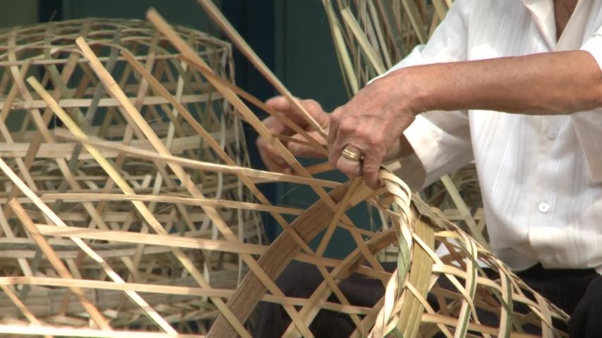 Human hands doing the work of weaving bamboo baskets | Shutterstock HD Video #1041311797