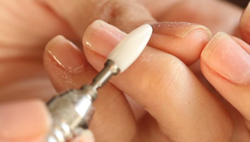 Woman removes gel laque polish with a manicure machine. Making manicure by herself . Selfmade manicure service | Shutterstock HD Video #1041705547
