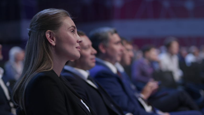 Business Meeting at Conference or Crowded Political Summit. Caucasian People Smile at Speaker Speech. Economic Briefing and Information for Success Strategy for Businesswoman. Row of Seats at Congress | Shutterstock HD Video #1041720427
